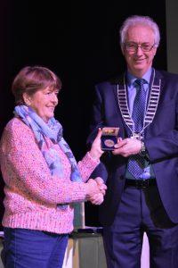 Rita Nolan receiving award