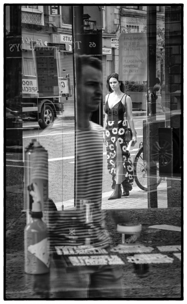 A241 Reflections in a barber shop window.