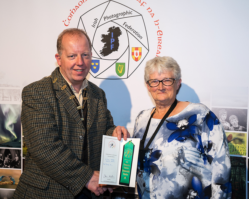 Dominic Reddin, FIPF presenting an Honourable Mention Certificate to Lilian Webb, AIPF, ARPS