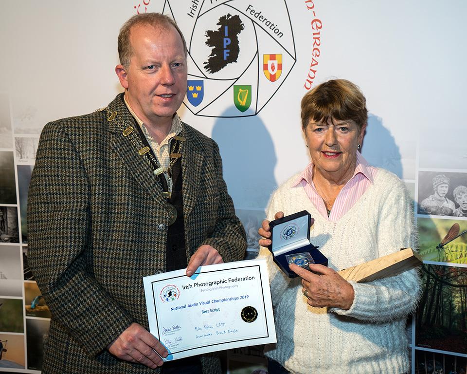 Dominic Reddin, FIPF presenting the Silver Medal to Rita Nolan, LIPF