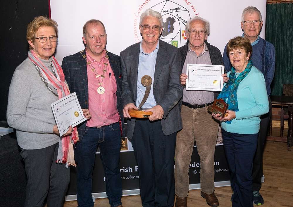 Dominic Reddin, President IPF, presenting Celbridge Camera Club members with the Best Sound Production & Best Club Trophies, October, 21st 2018